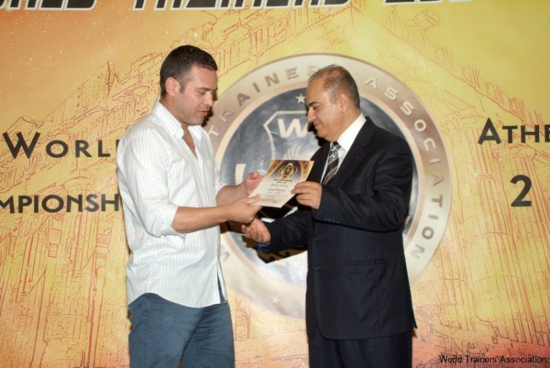 awarding mr. ioannis theofanous coach of the national kickboxing team of greece. a big thanks for his support in organizing the 1st world trainers competition